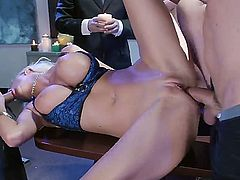 Busty hottie Courtney Taylor is lying on a table and being screwed hard by two horny blokes