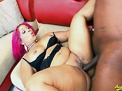 Thick black babe with cool pink hair gets down and dirty in this hot and wild video. She gets naked and opens her legs to get her pussy fucked hard.