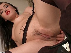 Nasty brunette with sexy red lips and in hot black stockings explores her ass hole. She stimulates her anus and bites her red juicy lips with pleasure.