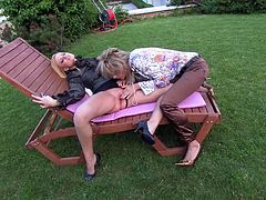 Two babe sin satin blouses are pleasing each other outdoor. One blonde penetrates her girlfriend's pussy and ass hole with her playful fingers and makes her moan with pleasure.