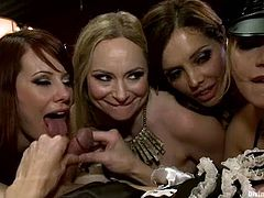 It's a crazy reverse gangbang or orgy you can put it, where the femdom action is the main thing. The girls are having a blast today with these guys.