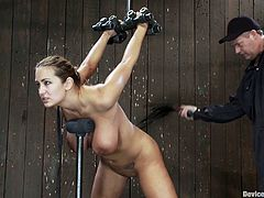 The beautiful girl with big tits Trina Michaels is having her butt cheeks spanked and her pussy toyed in this kinky bondage video.