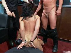 Sexy brunette chick gets undressed and face fucked in her office. Later on she gets fucked in her pussy and ass.