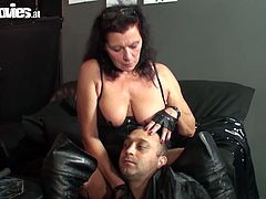 She is freaky mature woman wearing black leather corset and jackboots. Then orders her new maids to strip and crawl through the room. Then she hogties them. Creepy Fun Movies video.
