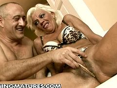 Check out sexy blonde granny Orhidea getting her hairy muff toyed. She is ready to squirt like never before and enjoys a big dildo!