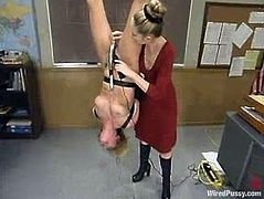 The submissive blonde is getting toyed and tortured with other kinky devices in this BDSM lesbian video packed going on in a classroom.
