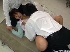 Dirty things go on in the teacher's lounge at this Osaka school. This beautiful teacher is being taken advantage of by all the male teachers. They hold her down, cover her mouth and spread her legs. Watch as they lick her thighs and pussy.