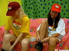 Zealous brunette and blond teens desire to gain delight on their own. Slim teen nymphos take off caps and loose bright T-shirts. Brunette spreads legs wide and jams tits while horny blondie rubs her pussy with pleasure.
