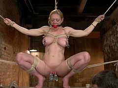 Blonde bitch named Darling is getting her punishment for being so nasty. She gets bound and loves being pulled by her pussy lips.