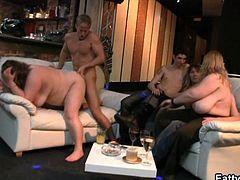 Watch a vicious and busty BBW brunette riding her man's dong in a sexy party before her clam gets fisted into a breathtaking explosion of pleasure.