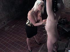 Blonde mistress Lorelei doesn't know how to play nice with men, and that's why we love her so much! She ties up her guy, makes him wear a leather mask and spanks him. For more pain, the hot blonde adds clothespins on his body, weights on his balls and much more. And that was only the physical torture!