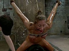 This sizzling and slender siren Ariel X is getting some pain and abuse from Mz Berlin and her partner. They put a ball gag in her mouth, so that she won't be loud.