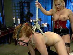 This lesbian domination video has Katja Kassin playing with Claire Robbins, tying her up, fucking her pussy with her strapon and more.