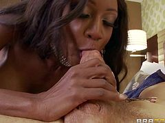 Dark skinned milf Diamond Jackson is a call girl with nice body. Leggy ebony woman in black nylons shows off her bubble ass and huge tits as she sucks white guys beefy cock on the bed.