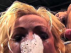 Cock hungry blonde bombshell Adrianna Nicole with big juicy hooters and colorful tattoos in high heels gives mind blowing blowjob to handsome stud with stiff pecker in close up.