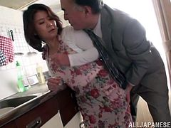 Japanese housewife gets her boobs massaged. After that she takes her dress off and gets fucked hard in a kitchen.