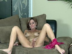 A dirty-ass mature whore gets naked for the camera and fucking sticks a hard toy in her fucking wet-ass pussy, check it out!