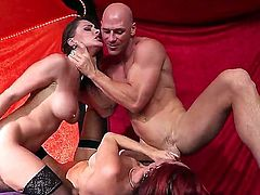 A thnreesome with two red heads on the huge dickss