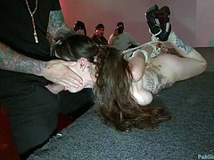 Bella Nikole Black is tied up, but it's not a private affair. She is put on stage of a theatre so everyone can watch her being tortured. She's hogtied and her master sticks his pecker into her mouth so everyone can enjoy the show. The audience opens her mouth to make sure she's swallowed the cum.