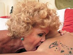 Charming blonde chick is playing lesbian games with some salacious blonde granny. They caress each other passionately and then the girl shows her pussy-licking skills to the grandmother.