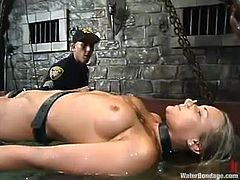 Justin and his GF Veronika are having fun in a jail. Justin binds the girl to the bars, plays with her pussy and then makes the chick take a swim.