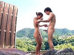 Kaho Kasumi has visited a famous resort town in Japan, that's known for its onsens. She goes into the hot water with her man and then the two fuck. He licks her nipples and eats her cunt. She sucks him off and then bends over so he can fuck her from behind.