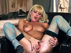 Sexy blonde Niki strips seductively as she shows off her gorgeous pussy and natural boobs