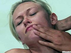 Blonde girl loses a battle to a brunette. So, she has to obey. She sucks a strap-on and then gets her pussy stuffed with it.