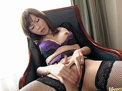 This sizzling and naughty Japanese siren Miki Yamashiro gets naked and starts flashing out her hairy pussy! Babe loves touching herself!