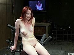 A gorgeous redhead fucking slut gets restrained by bondage machines and gets toyed with in this scene right here! Check it out!
