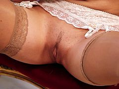 Amazing blonde cutie Sophia Knight is having a photo session indoors. She sits down on a chair near a fireplace and demonstrates her cute smooth pussy for the cam.
