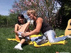As soon as slutty brunette with pigtails sees a dude playing the guitar on the lawn, she comes closer. It's a great chance to gain delight. Spoiled nympho with small tits induces him to eat her juicy teen pussy and repays with a blowjob right away.