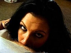 Brunette milf enjoys sucking a hard one while smoking and moaning