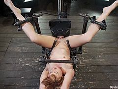 Check out this hot bondage scene with a redhead slut getting tied up by bondage devices in this hot scene right here! It's hot!