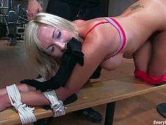 Hot Skylar Price undresses in a gym and gets tied up by her fitness instructor. After that he fucks this bitch in the ass.