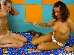 Two curvy fresh faced amateurs play computer games together before they get suddenly aroused. They take off each other's clothes to maul big milky tits and bearded pussies with pressure in sultry sex video by Seventeen Video.
