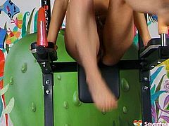 Fuckable blond Russian student strips by the fitness equipment wearing flirty lingerie before she sticks a huge dildo inside her gaped pussy that is attached to training machine.