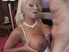 Hot and horny big boobed milf JR Carrington seduced to have sex by Mark Wood. They are having oral fun, he pushes penis between her boobs and then bangs cunt of the babe.