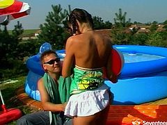 Perverse dude seduces a fresh faced long legged brunette amateur by the pool. He caresses her small perky tits with his tongue before she accepts his huge penis inside her mouth for a blowjob.