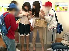 Two slim Japanese cuties get undressed by a few dudes in a subway. Then the guys play with the chicks' pussies and make them pee on the floor.