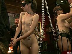 Bella Rossi and Kristine Kahill get chained and blindfolded. Later on they suck big dick and lick each others pussies.