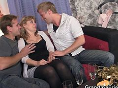 Watch this nice threesome hardcore video of granny getting fucked by two young cocks.She invites her young friends at home and enjoys drinking and fucking with them.