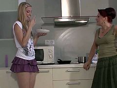 See a naughty blonde lesbian teen getting seduced by her boyfriend's redhead mother. Watch her fingering her shaved slit while making out on the kitchen counter.