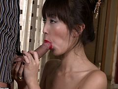 Her juicy red lips slide his huge pole up and down. She demonstrates deepthroat talent and perfect sucking skills. later she swallows his balls and gives slobbery blowjob.