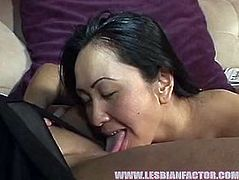 Ample Asian domina lies on the couch with legs wide open while a sizzling long haired brunette gives her tasty vagina a tongue fuck before they switch the roles and she is the one who pleases with pussy eating.