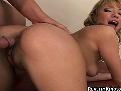 Curvaceous blonde girl strips her clothes off and shakes the ass. Then she fingers her pink pussy and gets fucked on a sofa.
