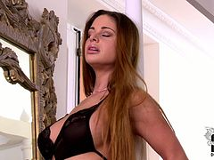 Long haired mom with curvy gorgeous body is wearing black tempting lingerie. She poses on cam in teasing position being talented seductress. Later in the video she fondles her pussy with fingers.