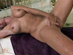 A tight blonde bitch gets naked dips in the bathtub and starts fondling her big tits and fingering her wet pussy, check it out!