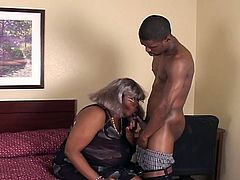 See a vicious ebony granny getting her pussy drilled deep and hard into heaven by a horny young stud.