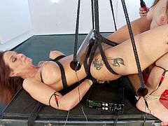 A kinky bondage scene featuring lesbians and fucking electricity being applied to cunt and tits, check it out right here!